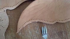 Use a fork to mark evenly spaced holes in leather (tutorial for a plague doctor mask)
