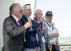 PEARL HARBOR,Dec.7,2014.4 of 9 remaining USS Arizona survivors,Donald Stratton,left,Louis Conter,John Anderson,& Lauren Bruner,toast in honor of fallen shipmates & service members of Dec.7,1941 Japanese attack on Pearl Harbor aboard USS Arizona Memorial at Joint Base Pearl Harbor-Hickam.4 survivors announced this year's USS Arizona Reunion Association ceremony to be final of kind.Final toast symbolizes brotherhood & sacrifice of day of the attack on Pearl Harbor 73 years ago.