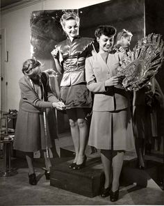 Models being fitted for a fashion show at Gude's Department Store on November 30, 1941 to showcase its latest creations at the biggest Lockheed-Vega dance of the year. The fashion show, at Riverside Drive Breakfast Club, was given in honor of 200 soldiers from Fort Mac Arthur. International Association of Machinists, District Lodge 727 Collection. San Fernando Valley History Digital Library.