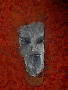 Uomo delle montagne dipinto su legno.