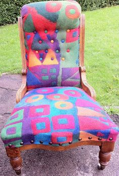 http://www.funkyfeltandfibres.com  Awesome felted chair cover