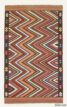 New+Turkish+Kilim+Area+Rug+hand-woven+in+Konya,+Turkey+with+vegetable-dyed+and+hand-spun+wool.+The+design+of+this+is+from+a+Labijar+Uzbek+kilim.+The+fringes+can+be+removed+upon+request.+If+you+like+the+design+of+this+rug,+we+can+custom+make+it+to+meet+your+color+and+size+requirements.