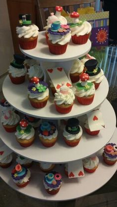 Alice in Wonderland theme mini cupcakes with fondant toppers.