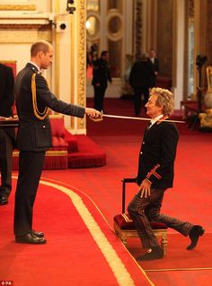 Arise! Rod Stewart knelt before Pince William while receiving his Knighthood for services ...