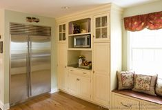 Idea of the Day: Antique White Kitchen Cabinets. (By Crown Point Cabinetry). Pretty, two tone antique white built in refrigerator Two Tone Kitchen Cabinets, Built In Cabinets, Kitchen Cabinet Design, Kitchen Cabinetry, Crown Point Cabinetry, Built In Refrigerator, Kitchen Pictures, Kitchen Ideas, Custom Kitchens