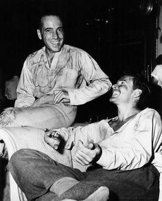 Between takes of Passage to Marseille, Humphrey Bogart visits Errol Flynn on the set of Uncertain Glory (late 1943)