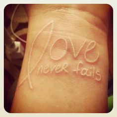 love never fails with jesus fish tattoo