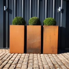 These beautiful Corten pots come in various sizes and can be used as screens or split for individual structure, I however like them together like in this image