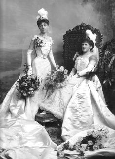 Court Presentation gowns. The white feather plumes let you know it is not a wedding photo. It was compulsory for both Married and Unmarried Ladies to Wear Plumes. The married lady's Court plume consisted of three white feathers. An unmarried lady's of two white feathers.  The veils should not be longer than 45 inches.