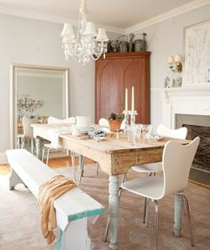 Warm touches. Rustic table with sleek chairs, and a touch of elegance with the chandelier.   LOVE this room!
