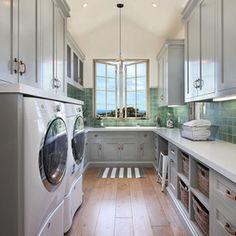 Mediterranean Laundry Room by Brandon Architects, Inc.