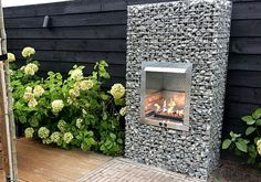 Gabion fireplace featured image Gabion Stone, Gabion Retaining Wall, Outdoor Fireplace Patio, Diy Fireplace, Diy Fence, Fence Landscaping, Gabion Baskets, Patio Pond, Container Water Gardens