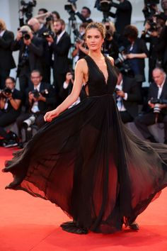 "Alessandra Ambrosio twirls at the ""Spotlight"" premiere at the Venice Film Festival"