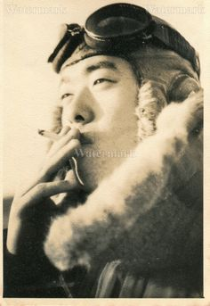 Japanese fighter pilot smoking a cigarette