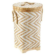 Our Chevron Bamboo Hamper creates subtle sophistication in any room! The simple chevron design is made of woven bamboo for added strength with handles on each side and on its lid. The reinforced wooden base allows it to raise a bit off of the floor and offers even more support.