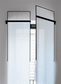 Contemporary window treatments by Antonio Citterio, Patricia Viel & Partners  [internal shutter : sheer fabric set into hinged metal frames]