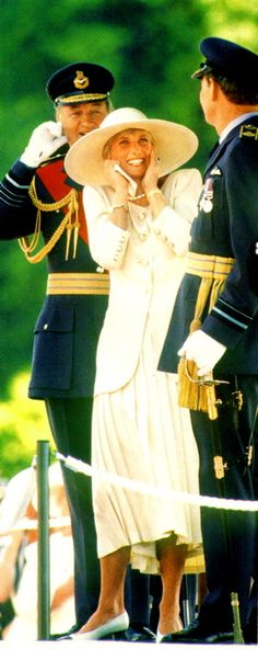 Diana, Princess of Wales in 1991 at a military engagement. Shielding her ears from the cannons.