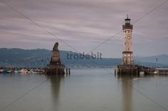 Harbour entrance of Lindau on Lake Constance with the old lighthouse and the Bavarian lion statue Bavaria Germany Europe