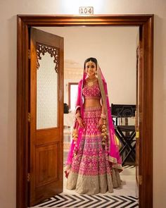 We love the look of this pink bridal outfit the color gives it a unique look away from the traditional red bridal outfits! A modern trend. Wedding Lehnga, Indian Bridal Lehenga, Indian Bridal Outfits, Indian Bridal Wear, Indian Dresses, Wedding Attire, Bridal Dresses, Indian Clothes, Bride Indian