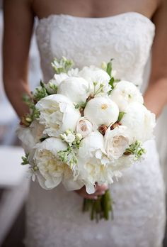 Brides.com: . Classic brides will love an all-white bouquet, like this option from Atelier Joya, which is filled with lush peonies and garden roses.