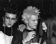 """Steve Strange, Billy Idol and girlfriend Perri Lister at """"Hell"""" in London by Robert Rosen… """" Perri Lister danced topless in the 1982 Duran Duran video for the single release """"The Chauffeur"""". Billy Idol, Leigh Bowery, Thompson Twins, Blitz Kids, Play That Funky Music, Stranger Things Steve, The Blitz, New Romantics, Charming Man"""