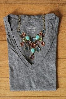 gray tee, statement necklace. with black skinnies and brown boots, maybe a cute cardigan to keep warm...