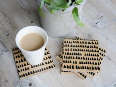 Rows of abstract houses welcome your mug on these hand printed wooden coasters. Black ink on natural birch. Buy a set or peruse other patterns at keephousestudio