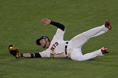 Description of . San Francisco Giants' Gregor Blanco (7) slides to catch a hit by St. Louis Cardinals' Matt Holliday (7) in the fifth inning of Game 5 of the National League baseball championship series at AT&T Park in San Francisco, Calif., on Thursday, Oct. 16, 2014. (Jose Carlos Fajardo/Bay Area News Group)