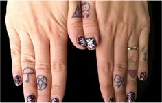 omg I love the tooth and the deathly hallows! all she needs is a mockingjay