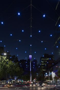 """Lonsdale Gateway"", the catenary lighting structure at the intersection of Lonsdale and Russell Streets in Melbourne, celebrates entry into the city's Greek precinct. Positioned above one of Melbourne's busiest intersections and tensioned between four structural spires, the structure utilises a cable net with two main spines, East-West and North-South, to suspend 144 Greek inspired programmable LED lights in a spectacular display of light."