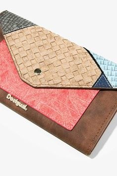 Brown wallet with a combination of materials with different textures.