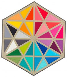 """Prismatic Medallions"" pattern designed by Susan Kephart. Features Kona Cotton. Finished mini quilts have assorted sizes. FREE pattern."
