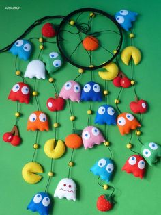 Felt mobile with the characters of Pacman. Light, to hang a curtain rod or hook to the ceiling. Measurements from the green circle: 44 x 17 cm Not a toy, for decoration only. Each mobile is unique, no two alike. Ready to ship. Mario Crafts, Pac Man, Fuzzy Felt, Nerd Room, Felt Crafts Patterns, Felt Mobile, Arts And Crafts, Diy Crafts, Love Craft