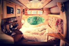 Drive away on your post-wedding adventure in this narrowboat-style campervan. Cosy bed - tick, dreamy decor - tick, porthole window - tick!