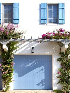 Pergola over garage door...much more inviting. {cottage look}
