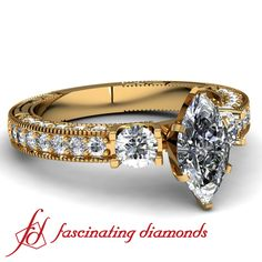 Marquise cut yellow gold diamond engagement ring