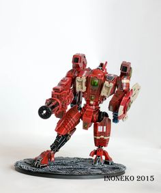 Red and Beige XV104 Riptide Battlesuit. Check out https://www.facebook.com/Inoneko-model-painting-247182882290975 for more!