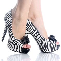 Zebra Shoes make me feel sassy. And I think I'm sassy enough to pull of zebra print pumps.