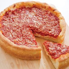 Chicago Style Deep Dish Pizza has an airy, flaky crust with a lightly crisp outside, and a rich taste that can hold its own under any topping.