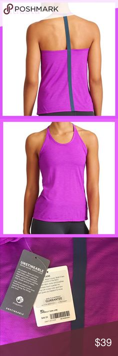 NWT Athleta Uppercut Tank Beautiful magenta Athleta tank with charcoal blue back. Very flattering lines and nice soft material made from the Athleta Unstinkable fabric. I also have it in royal blue and Grey. Athleta Tops Tank Tops