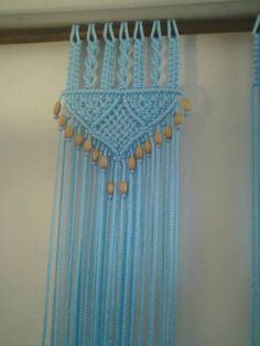 PRICE LISTED IS FOR ONE Hand Knotted Macrame Decorative Panel for a Wall/ Window or Door Treatment in a 6 MM(1/4 inch diameter) cord. Color of cord in photo #1 is called Sky Blue. Other colors available. It looks like cotton rope but is not natural cotton. This cord is washable, colorfast and durable. The cords hang down loose after the top design with a bead per two strands at the bottom. The Intricate Knotted Design in photo #1 is my design called, Bead Fringed Door Decor. {16...