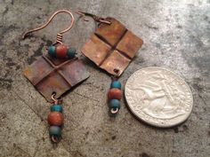 Rustic copper earrings, folded metal, turquoise dangle earrings. Flame painting create these rich and complementary subtle colors from green to blue to orange to magenta.  I handcrafted these light weight earrings from a flat copper sheet by cutting the shape, fold forming and flame painting the metal. The folds are in a 4 square pattern. Natural red (rust) Aventurine and matte teal blue Zircon rainbow beads accent the folded metal design. The flame painting is created with a torch technique…