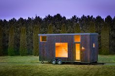 ESCAPE One is a 276-square-foot tiny house on wheels with a rustic yet minimalist interior that can easily sleep four people.