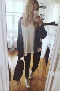 Cute casual outfit, very 90s. White oversized/boyfriend tee, dark blue plaid button up, black  skinny jeans, white converse, black bag