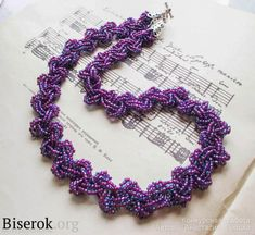 necklace of purple beads.  Translate.  ~ Seed Bead Tutorials