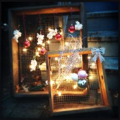 Holiday lights on chicken wire box - simple yet so pretty. Most of the ornaments I added were from Dollar Store, then I just wove a string of lights between the two. Holiday Lights, Holiday Decor, Chicken Wire, String Lights, Dollar Stores, Weaving, Christmas Tree, Table Decorations, Ornaments