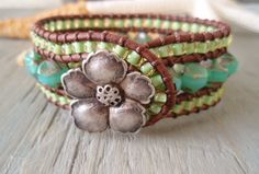 Beachy leather cuff bracelet 'Hawaiian Aloha'  aqua seafoam, lime green, opal glass, hibiscus, luxe tropical boho beach glam. $93.00, via Etsy. ( would love this but would never pay that!)