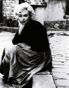 Milton H. Greene, Marilyn Monroe, Seated on a Pavement Wearing a Peasant Skirt