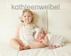 It would be hard to get the toddler to sit while you posed the baby but it would be worth it--so cute! This is so beautiful and its a great birth announcement pose idea. {Sibling / Family / Children / Newborn / Photography}
