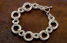 Learn Chain Maille Jewelry Making: How to Make a Flower Unit (Möbius) Bracelet by Karen Karon in her Chain Maille Jewelry Workshop book.